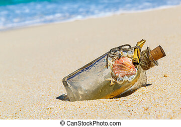A bottle with a message, which made the sea on the sand of a tro