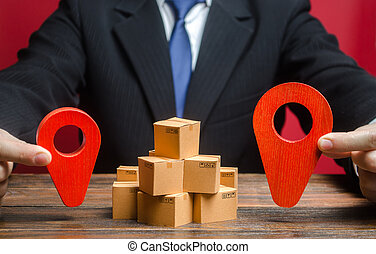A businessman sets a destination for goods delivery. Global market and business, import and export. Trade in new markets. Distribution, freight transportation shipment. Logistics and warehousing.