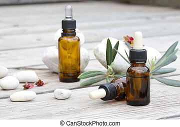 A dropper bottle of an essential oil