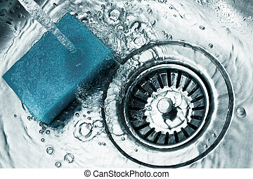 a stainless steel kitchen sink drain, detail