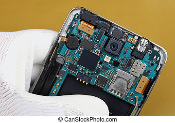 A technician repair printed circuit board for for wireless mobile phone