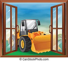 A window with a bulldozer