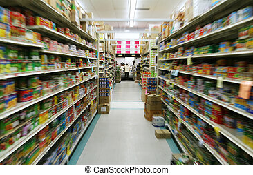 an aisle in a supermarket, zoom motion to blur the brands on products.