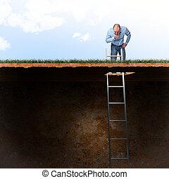 man look into ground hole