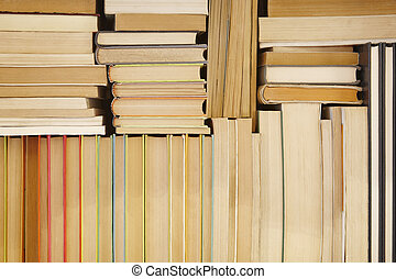 Antique books stacked on a storage rack. Read background
