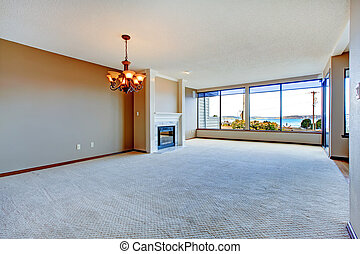 Apartment living room with large windows.
