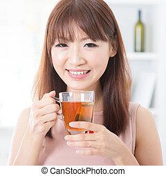 Asian girl enjoying tea