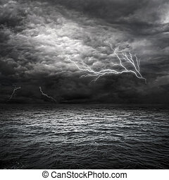 Atlantic Ocean Storm setting in. Lightning over storm clouds above the sea.