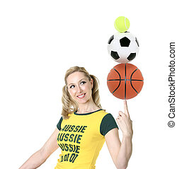 Cheerful, Aussie girl in green and gold balancing sporting balls.