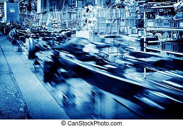Factory floor, car production line, motion blur picture.