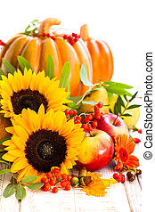 Autumn still life with seasonal fruits, vegetables and flowers