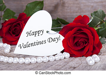 Background with Roses and a white Heart Label with Happy Valentines Day on it