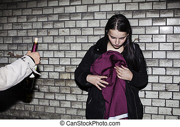 bad neighborhood influence concept: lifestyle teenage with alcohol abuse, drinking vine at night, real junky teen girl