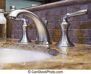 Extreme closeup of bathroom faucet