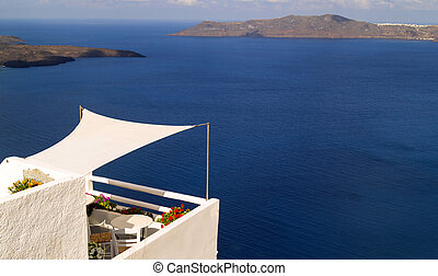 Beautiful balcony in Oia village, Santorini island, Greece