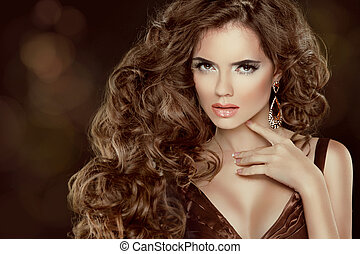 Beautiful brown hair, Fashion Woman Portrait. Beauty Model Girl with luxurious wavy long hair isolated on dark background