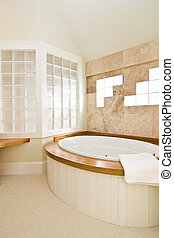 beautiful upscape residential bathroom with whirlpool tub