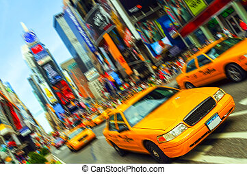 Beautiful Vibrant New York City Taxi, Times Square, Motion Blur. All logo and trademarks are blurred out.