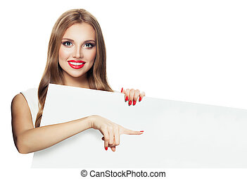 Beautiful woman pointing and holding white empty paper signboard isolated on white background