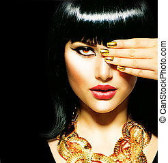 Beauty Brunette Egyptian Woman. Golden Accessories