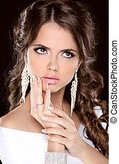 Beauty fashion brunette girl model portrait. Make up. Hairstyle. Jewelry. Studio Photo