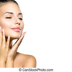 Beauty Spa Woman Portrait. Beautiful Girl Touching her Face