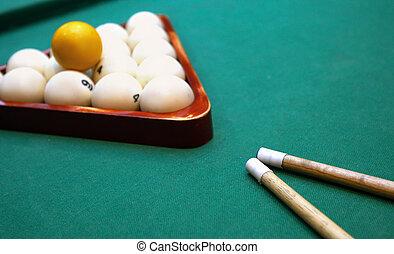 Billiards. Top view of billiard balls and cues