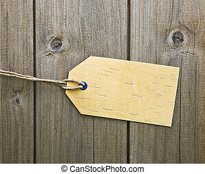 Blank Price Tag On Wooden Background