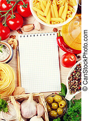 blank recipe book on a table with vegetables