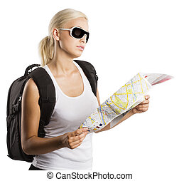 young blond girl with sunglasses looking at map isolated on white