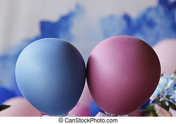 Blue and pink balls at revelation tea party - baby gender reveal party concept