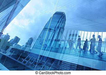 Abstract modern city background with people walking over buildings reflections.