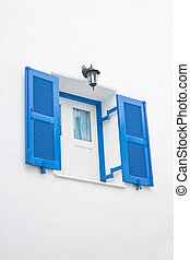 Blue open window with white wall.