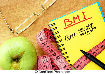 BMI body mass index formula in a notepad.