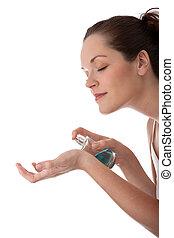 Body care series - Beautiful woman applying perfume