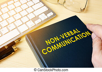 Book about NVC Non-verbal communication on a table.