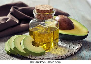 bottle of avocado essential oil