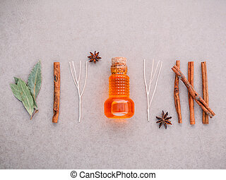 Bottle of essential oil with cinnamon stick