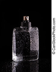 Bottle of perfume on a black background.