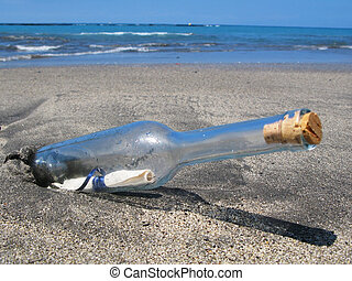 Bottle with a message on the black sand of Tenerife island, Canaries