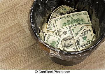 A money is in a trash bucket