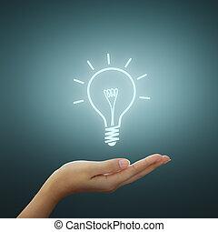 Bulb light drawing idea on woman hand