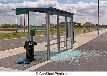 Bus stop vandalised by smashing the glass windows.