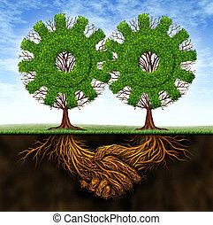 Business agreement and cooperation resulting in financial growth between two partners working together with the concept of two gear shaped trees with roots in the form of a hand shake.