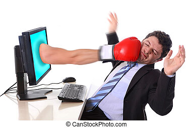 Business man with computer hit by boxing glove in stress and crisis concept