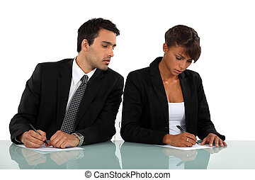 Business people filling in a form