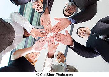 business team hands together