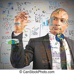 Businessman drawing a new project with a pen