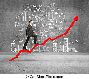 businessman rise on chart and drawing concept on wall