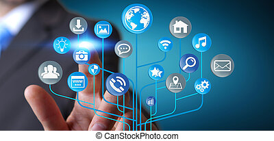Businessman using modern digital electronic circuit with icons
